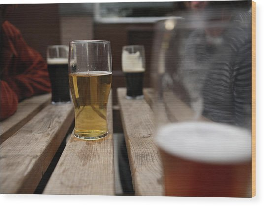 Pints Of Lager On A Pub Table Wood Print