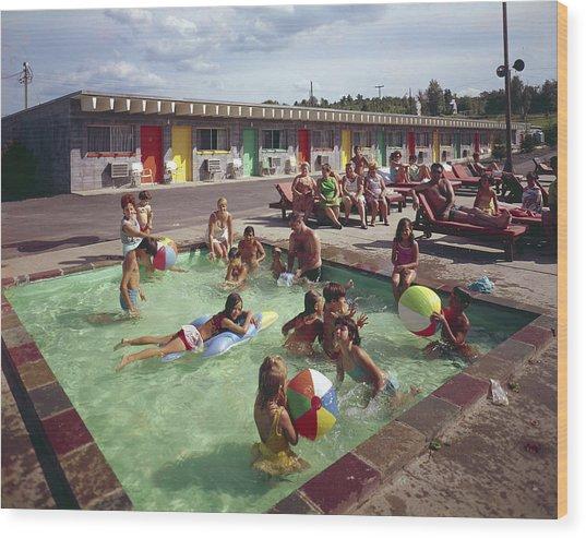 Poolside Fun At Arca Manor Wood Print by Aladdin Color Inc