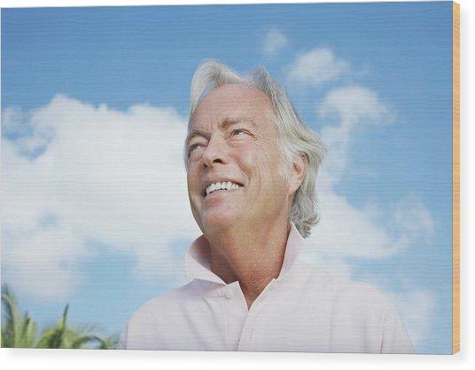 Portrait Of Senior Man Against Sky Wood Print