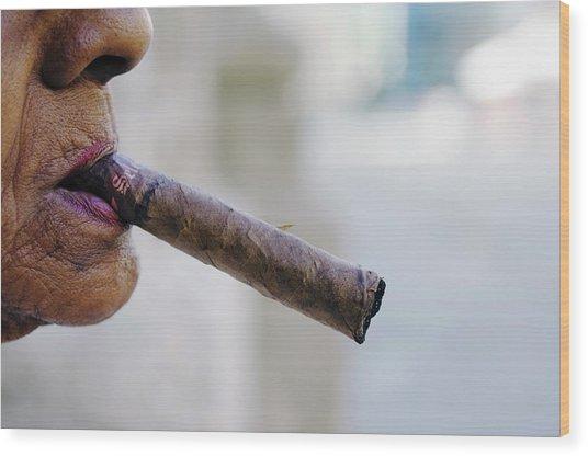 Profile Of Cuban Woman Smoking Cigar In Wood Print by Christian Aslund