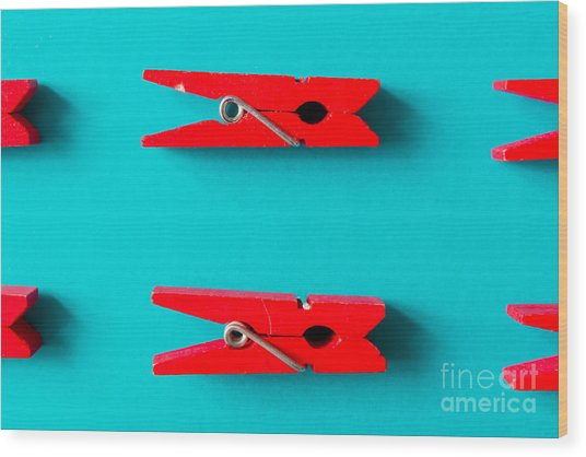 Red Clothespins On Cyan Background Wood Print by Zamurovic Photography