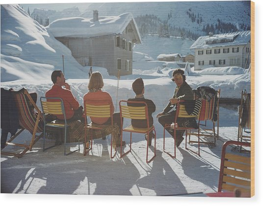 Relaxing In Lech Wood Print by Slim Aarons