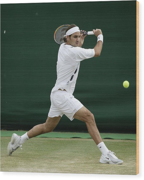 Roger Federer Of Switzerland In Action Wood Print by Phil Cole