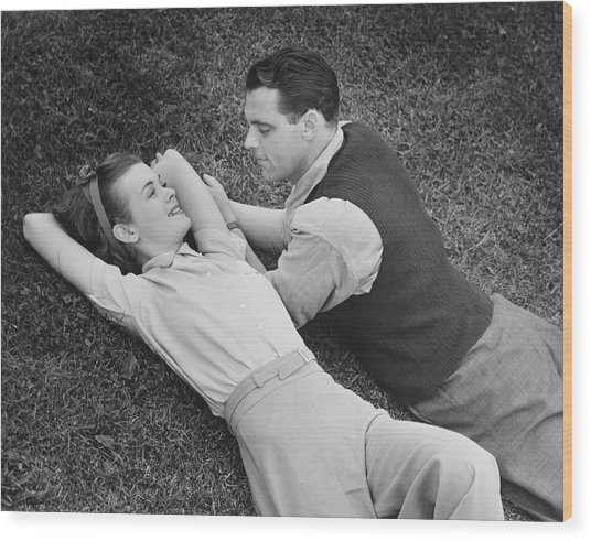 Romantic Couple Lying On Grass, B&w Wood Print by George Marks