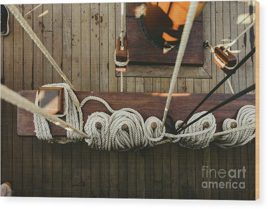 Ropes To Hold The Sails Of An Old Sailboat Rolled. Wood Print