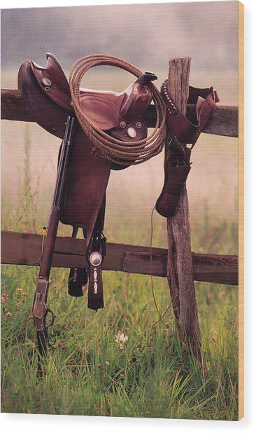 Saddle And Lasso On Fence Wood Print by Comstock
