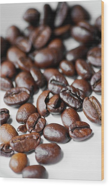 Scattered Whole Roasted Coffee Beans On Wood Print
