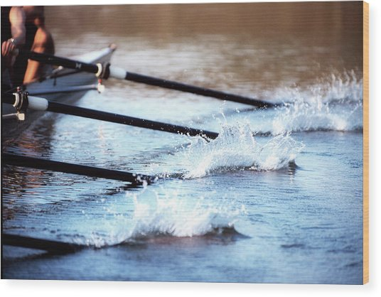 Sculling Team Rowing On Water Wood Print