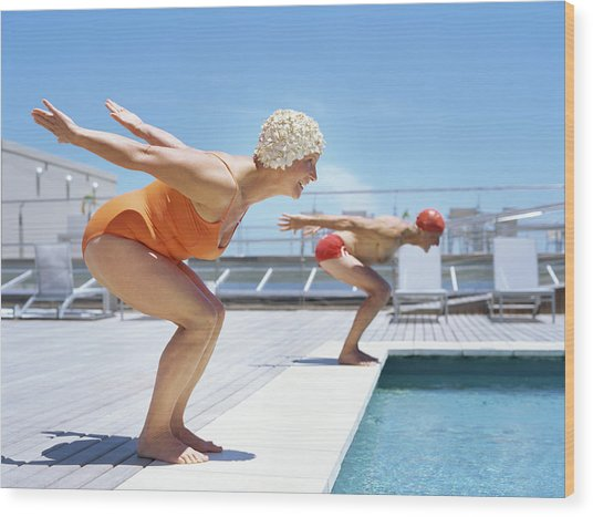 Senior Couple Ready To Dive In To Wood Print