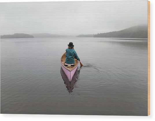 Senior Woman Canoeing Solo On A Misty Wood Print