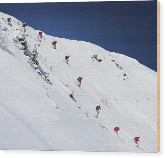 Sequence Of Male Skier Jumping Down Wood Print