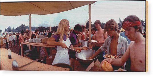 Several Young People Dishing Out Food To Wood Print by John Dominis