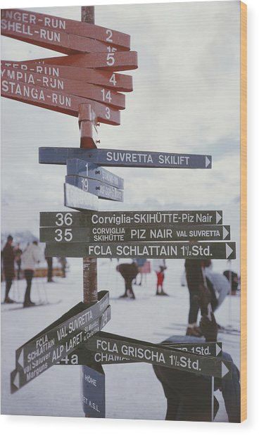 Signpost In St. Moritz Wood Print by Slim Aarons