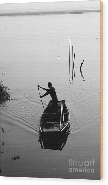 Silhouette Of A Boatman Rowing A Wood Print