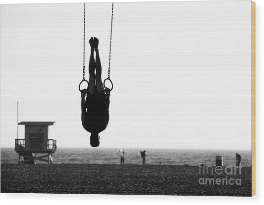 Silhouette Of A Person Swinging On Wood Print