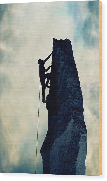 Silhouette Of Man Climbing Rock Wood Print