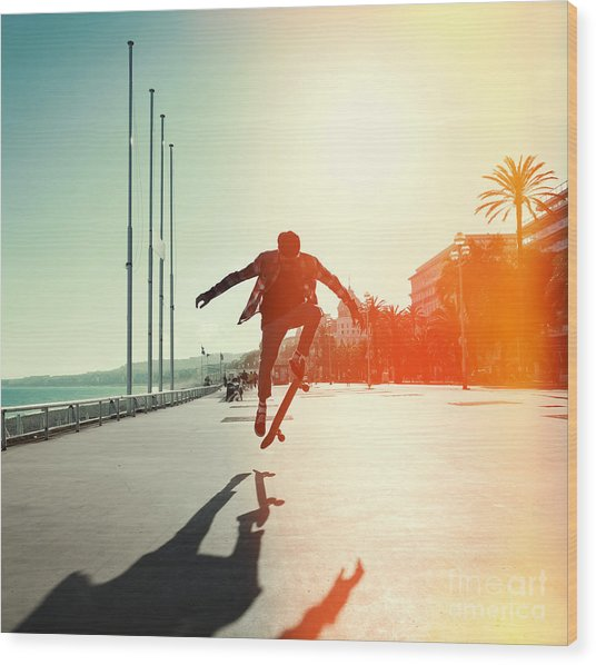 Silhouette Of Skateboarder Jumping In Wood Print
