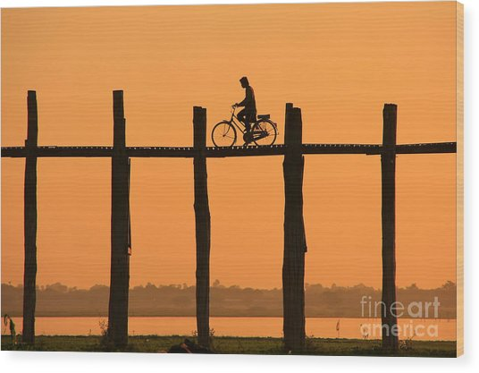 Silhouetted Person With A Bike On U Wood Print