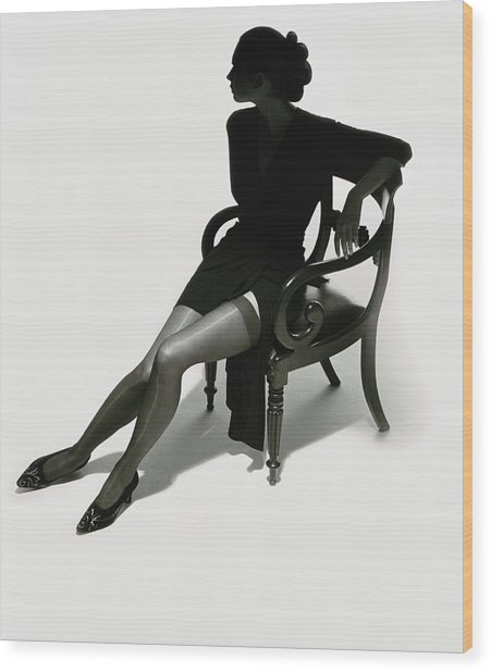 Silhouetted Woman On Chair Wood Print