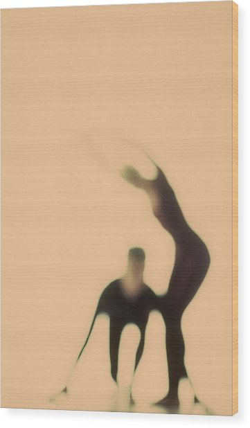 Silhouettes Of Couple Doing Exercises Wood Print
