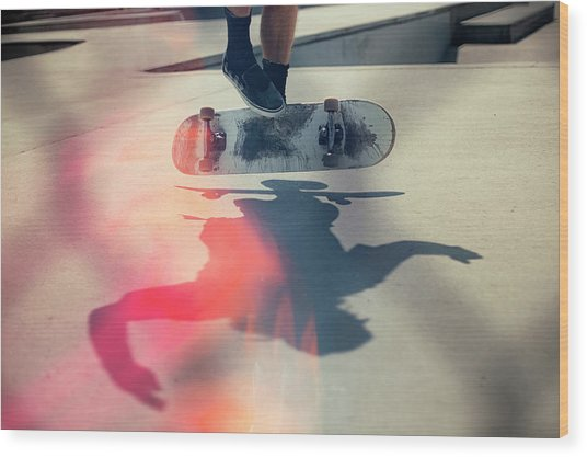 Skateboarder Doing An Ollie Wood Print by Devon Strong