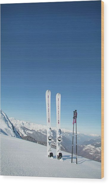 Skis And Ski Poles Stuck In The Snow Wood Print