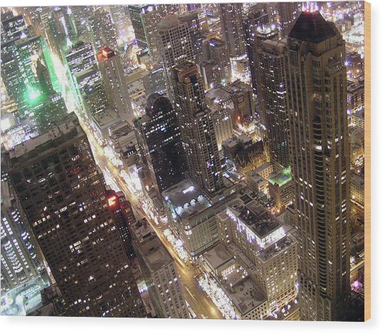 Skyscrapers Illuminated At Night Wood Print by By Ken Ilio