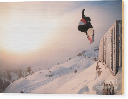 Snowboarding Off A Cliff Off Piste On A Wood Print
