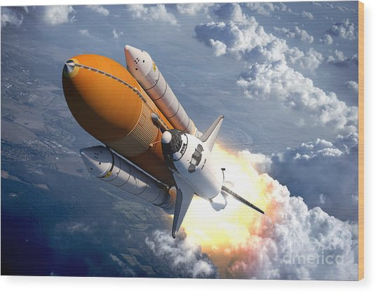 Space Shuttle Flying Over The Clouds Wood Print
