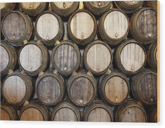 Stacked Oak Barrels In A Winery Wood Print