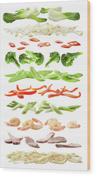 Stirfry Ingredients Separated Into Wood Print by Johanna Parkin
