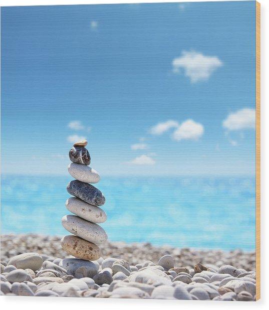 Stone Balance On Beach Wood Print by Imagedepotpro