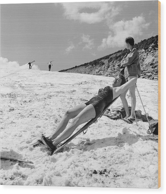 Sunbathing Skier Wood Print by Don