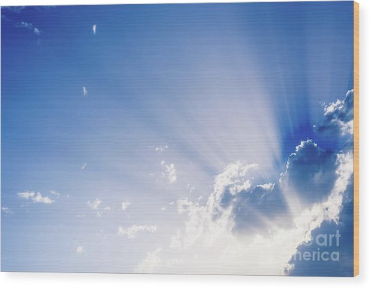 Sunbeams Rising From A Large Cloud In Intense Blue Sky On A Summer Afternoon Wood Print