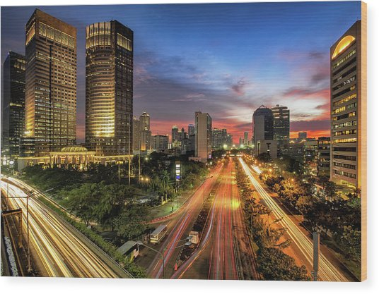 Sunset In Jakarta Wood Print by The Trinity