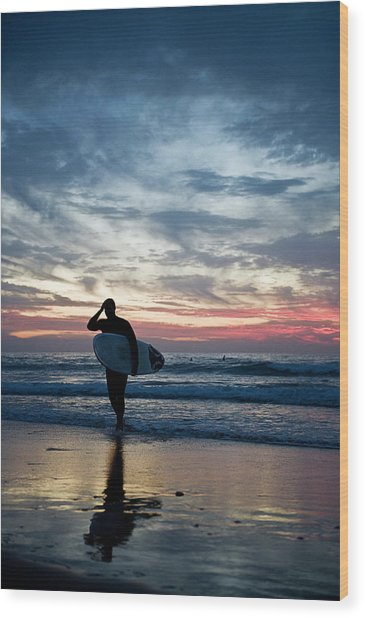 Surfer At The Ocean At Sunset Wood Print by Daniel Reiter / Stock4b