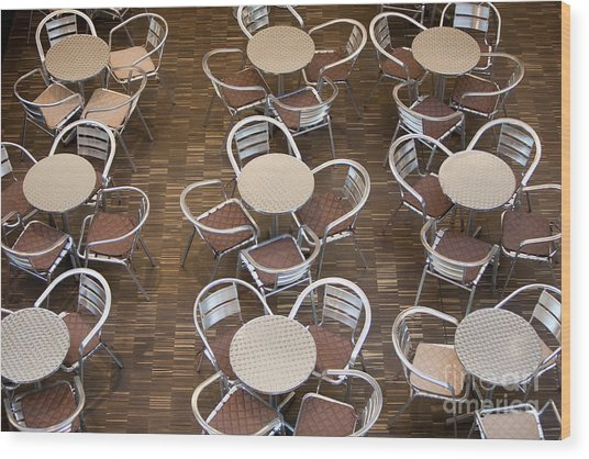 Tables And Chairs In A Restaurant Wood Print
