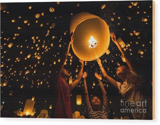 Thais Family Release Sky Lanterns To Wood Print