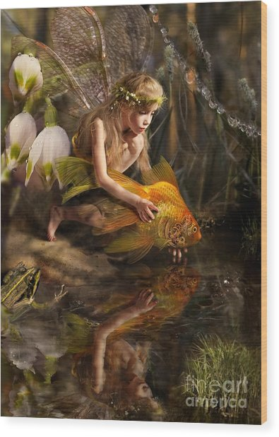 The Girl Releases A Gold Fish Wood Print