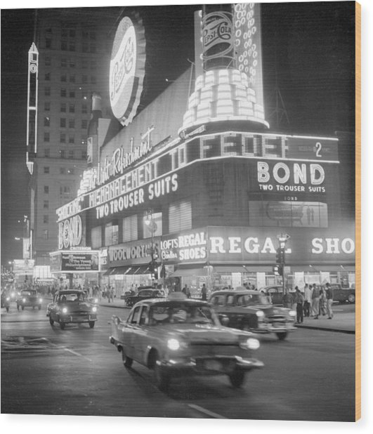 Traffic And Stores In Times Square Wood Print by Bettmann