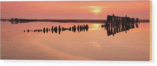 Tranquil Coastal Sunrise With Old Wood Print by Avtg