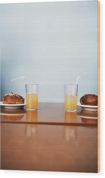 Two Cinnamon Buns And Two Glasses Of Wood Print by Johner Images