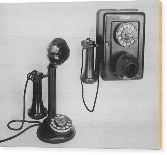 Two Old-fashioned Telephones Wood Print by Authenticated News