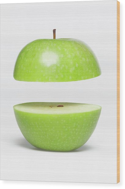 Two Parts Of Apple With Copyspace Wood Print by Jazzirt