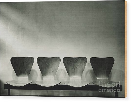 Waiting Room With Empty Wooden Chairs, Concept Of Waiting And Passage Of Time, Black And White Image, Free Space For Text. Wood Print