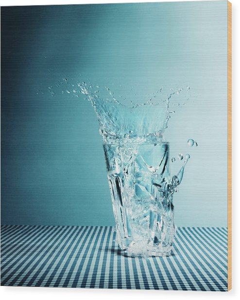 Water Splashing From Broken Glass Wood Print by Henrik Sorensen