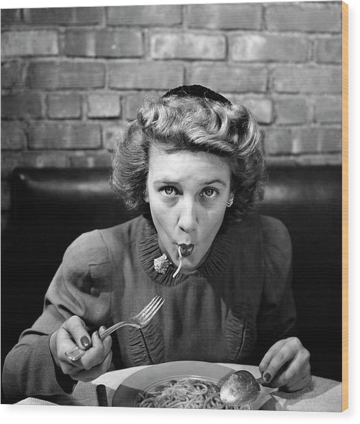 Woman Eating Spaghetti In Restaurant 5 Wood Print by Alfred Eisenstaedt