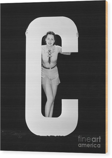 Woman Posing With Huge Letter C Wood Print by Everett Collection