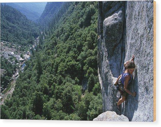 Woman Rock Climbing High Above River Wood Print by Heath Korvola