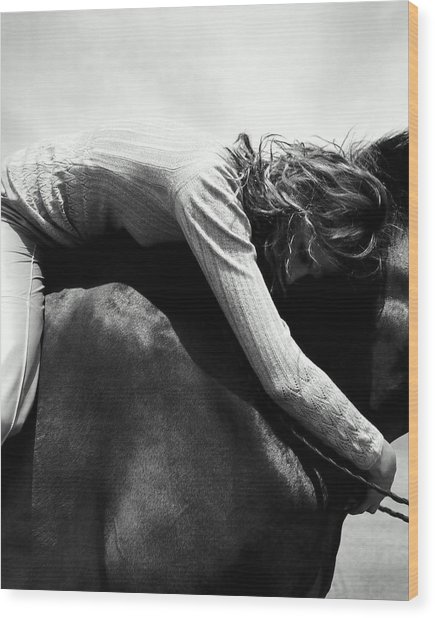 Woman Sitting On Horse, Arms Around Wood Print